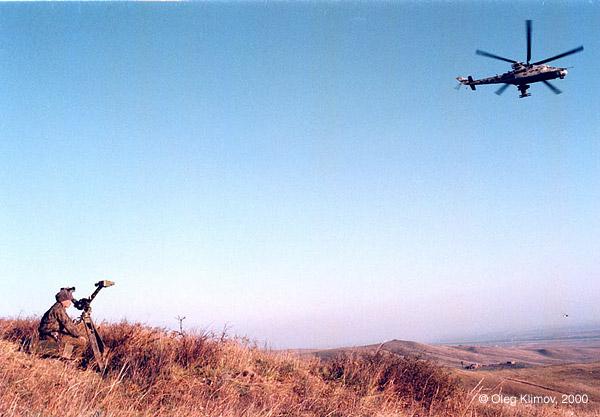 ©Олег Климов. «Корректировка огня при бомбардировке чеченской<br> деревни российскими войсками. Чечня, 1999»