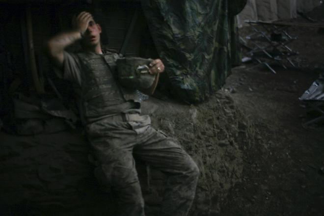 World Press Photo of the Year 2007<br /> <b>Tim Hetherington</b>, UK, for Vanity Fair<br /> <i>American soldier resting at bunker, Korengal Valley, Afghanistan, 16 September</i>