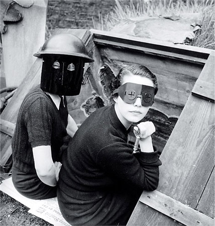 Women in fire masks in wartime, London, 1944