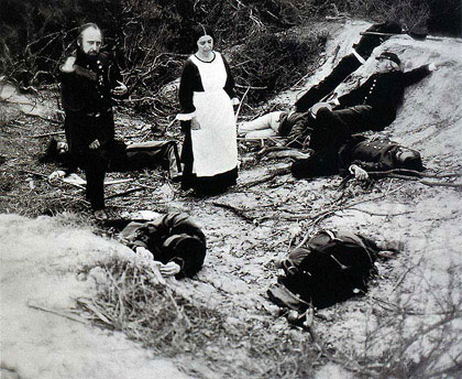 """Eleanor Antin.  """"The Angel of Mercy"""". 1977. """"In the Trenched of Sebastopol"""" from """"My Tour of Duty in the Crimea"""". One of 38 tinted gelatin-silver prints, mounted on handmade paper with text, 30 x 22 inches.  Courtesy Ronald Feldman Fine Arts, New York"""