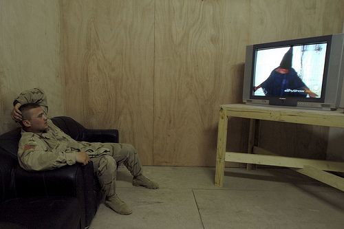 Specialist William Wimberly watches George W. Bush apologize on behalf of the US military for the torture that took place at Abu Ghraib prison.