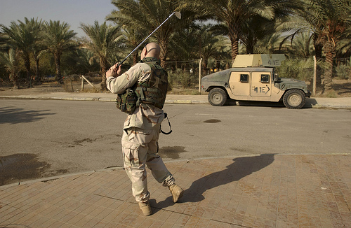 An officer from the third Infantry Division practices his swing on Christmas Eve in Baghdad. (c) Ashley Gilbertson
