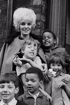 Woman with local children, Liverpool, 1966 Philip Jones Griffiths/Magnum Photos. 