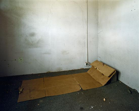 PIETER HUGO. Cardboard bed in an abandoned building, 2006. C-print. 132.5 x 157 cm