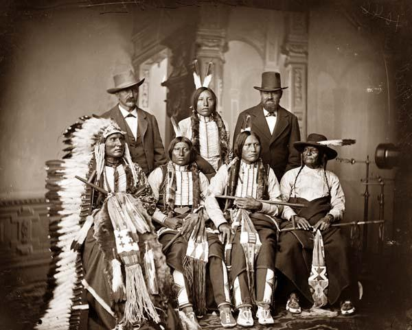 "Above we show a moving photo of Group of Sioux Indians ""Spotted Tail"" (photo c. 1875) Standing: Joe Merrivale; Young Spotted Tail; Antoine Janis; Seated: Touch-the-Clouds; Little Big Man; Black Cool; last two are rapoves[?] indentified by George E. Hyde 4229 Dangler[?] St. Omaha, Nebraska."