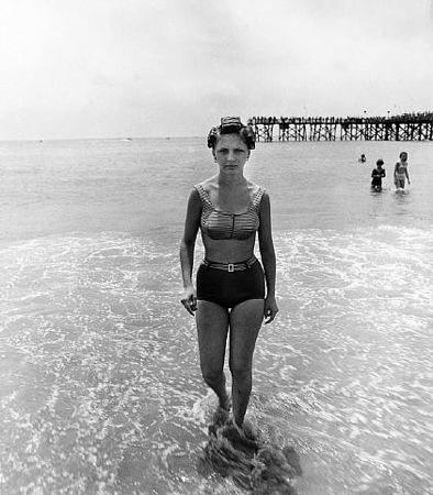 Diane Arbus.  Girl emerging from the ocean in curlers, Coney Island, N.Y., 1963