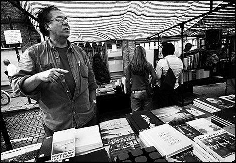 Making the call: Neil Burgess is at his photo-bookstall in London's Broadway Market most Saturdays. Photo © David Hoffman.