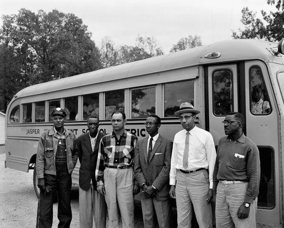 Alonzo Jordan, Men in front of school bus, Jasper, Texas, October 29, 1959. © 1996 Documentary Arts, Inc.