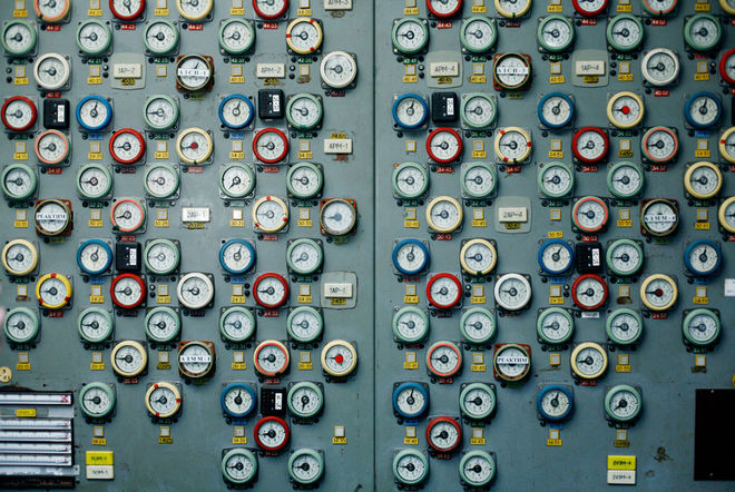 A wall of dials in the 1st Block Control Room once indicated levels for each of the rods in the reactor. Although the plant stopped producing electricity in 2000, nuclear fuel remains stored in three reactor halls. Photo: Michael Forster Rothbart.
