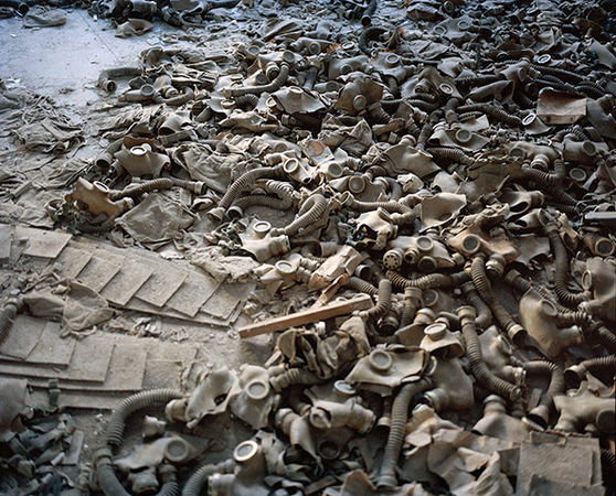 Rena Effendi, from the series Still Life in the Zone (Gas Masks Scattered on the Floor of a School Lobby in the Abandoned City of Prypiats. As a Result of the Nuclear Accident and the Subsequent Radioactive Fallout the Entire Population of Prypiats Had Been Evacuated and Never Returned Home, Chernobyl, Ukraine, December 2010)