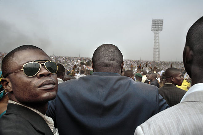 Guy Tillim, from the series Congo Democratic (Presidential Candidate Jean-Pierre Bemba Enters a Stadium in Central Kinshasa Flanked by His Bodyguards During an Election Rally, Kinshasa, Democratic Republic of the Congo, July 2006)