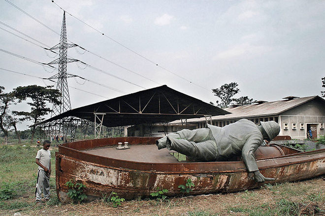 Guy Tillim, from the series Congo Democratic (Statue of Stanley That Used to Overlook Kinshasa. It Was Cut Down During the Mobutu Period of Africanisation in the 1970s and Dumped in an Unused Lot in Kinshasa, Democratic Republic of the Congo, July 2003)