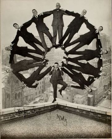 Man on Rooftop with Eleven Men in Formation on His Shoulders , ca. 1930<br> Unidentified American artist