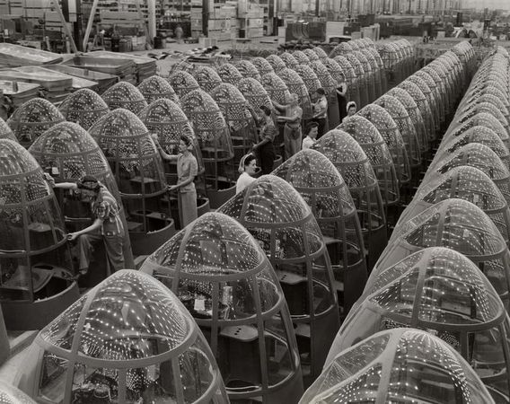 Alfred Palmer, Women aircraft workers finishing transparent bomber noses for fighter and reconnaissance planes at Douglas Aircraft Co. Plant in Long Beach, California, 1942, gelatin silver print, the MFAH, gift of Will Michels in honor of his sister, Genevieve Namerow.