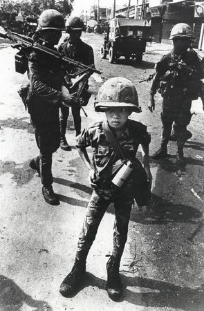 """Philip Jones Griffiths, Called """"Little Tiger"""" for killing two """"Viet Cong women cadre""""—his mother and teacher, it was rumored, Vietnam, 1968, gelatin silver print, the Philip Jones Griffiths Foundation, courtesy of Howard Greenberg Gallery. © Philip Jones Griffiths / Magnum Photos"""