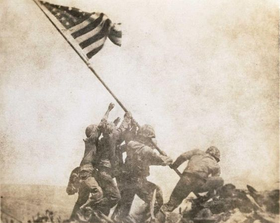 Joe Rosenthal, Old Glory Goes Up on Mt. Suribachi, Iwo Jima, 1945, gelatin silver print, the MFAH, Manfred Heiting Collection, gift of the Kevin and Lesley Lilly Family. © AP / Wide World Photos