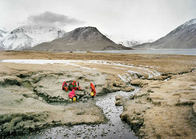 Wakhi women fetching water at the spring. Sarhad village, Wakhan, Afghanistan. © Matthieu Paley