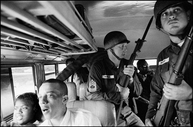 USA. Montgomery, Alabama. 1961. National Guard soldiers escort Freedom Riders along their ride from Montgomery to Jackson, Mississippi. © Bruce Davidson/Magnum Photos