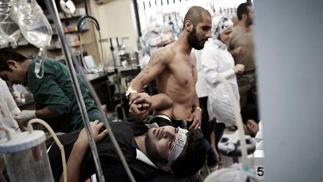 Себастьяно Томада / Sipa Press. Раненый боец Сирийской свободной армии в одной из больниц города Алеппо, Сирия, октябрь, 2012 г.