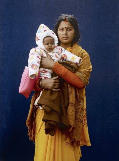 Kumbh Mela Pilgrim - Mamta Dubey and infant by Giles Price © Giles Price
