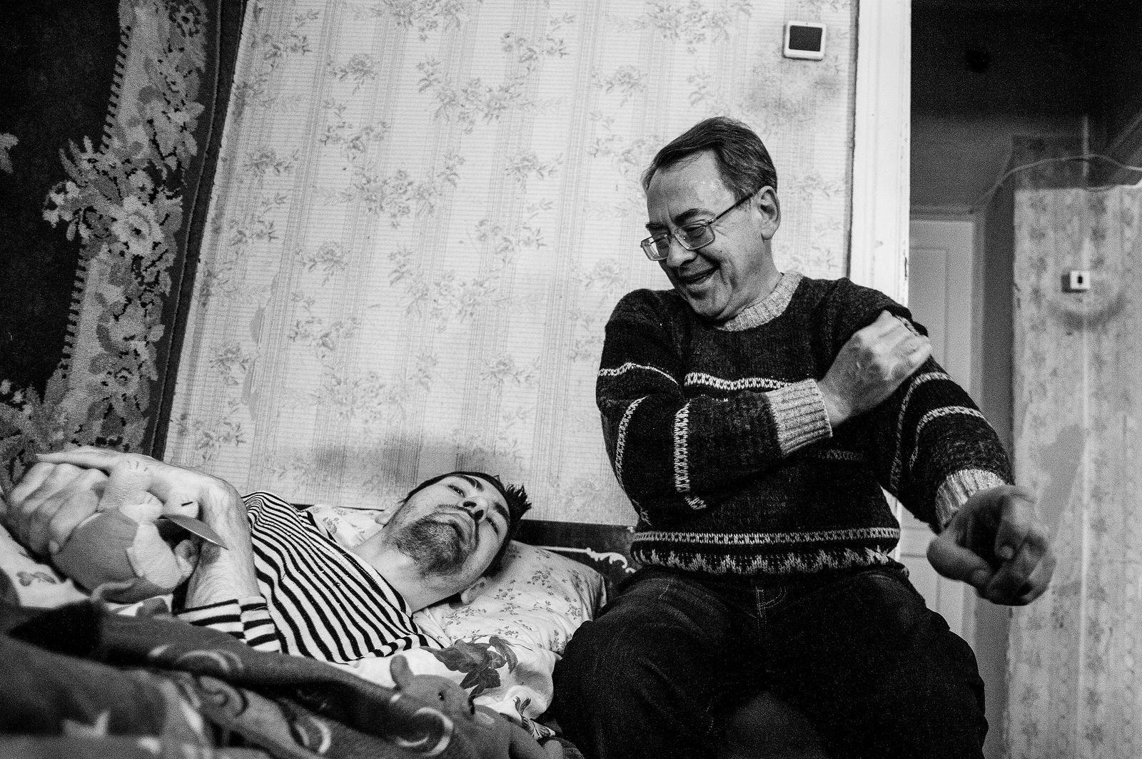 """Arik Shraga. """"Joint"""" Families: The Stories of Love. Kherson. Dima with his father"""