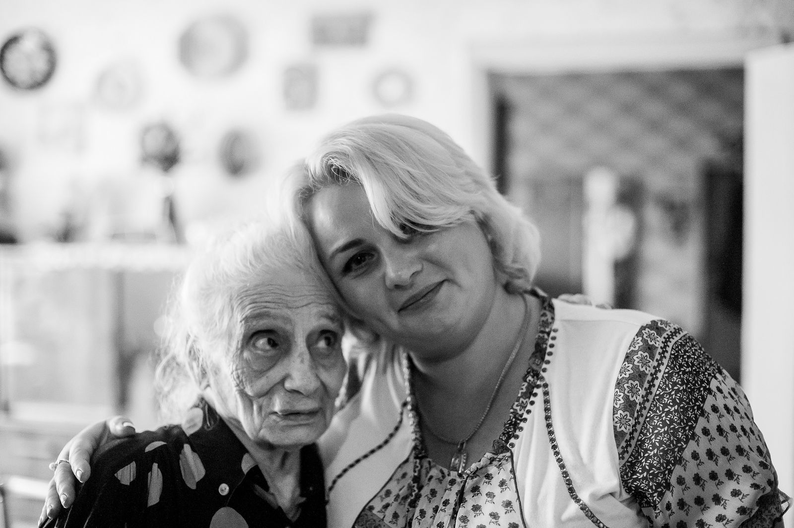 """Arik Shraga. """"Joint"""" Families: The Stories of Love. Kiev. Doba with her homecare worker"""