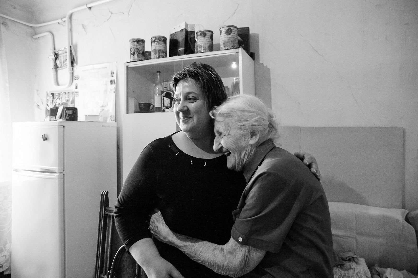 """Arik Shraga. """"Joint"""" Families: The Stories of Love. Zhitomir. Perel and her homecare worker"""