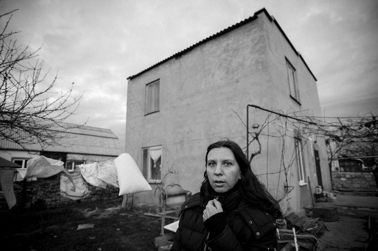 Arik Shraga. Ukraine. Olga in her backyard